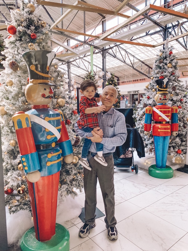 man and child standing by a Nutcracker at Easton Town Center, Columbus, Ohio