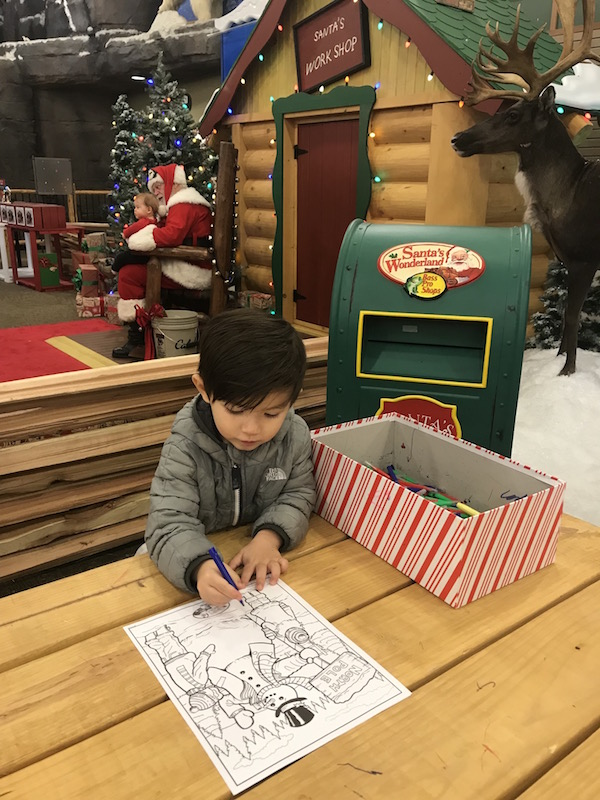 Child coloring a picture at Cabela's in Columbus, Ohio