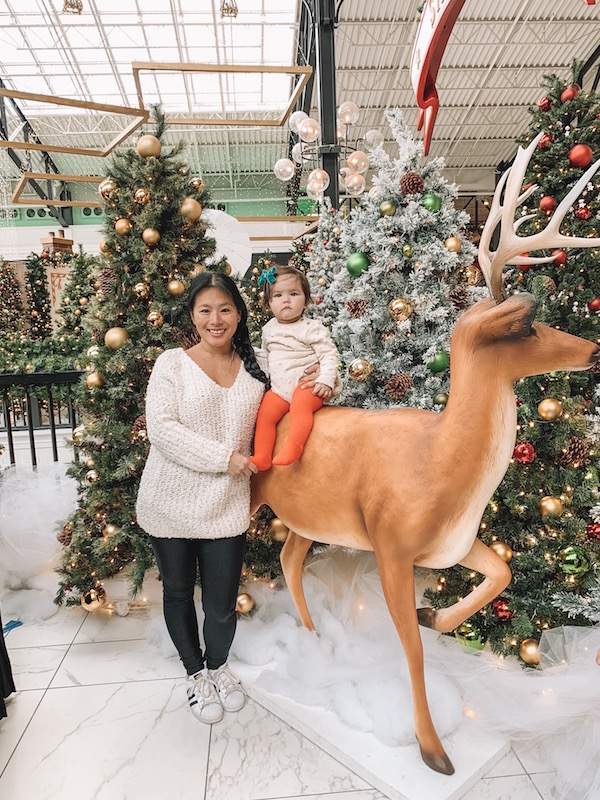 mother and child standing in Christmas scene at Easton Town Center in Columbus, Ohio