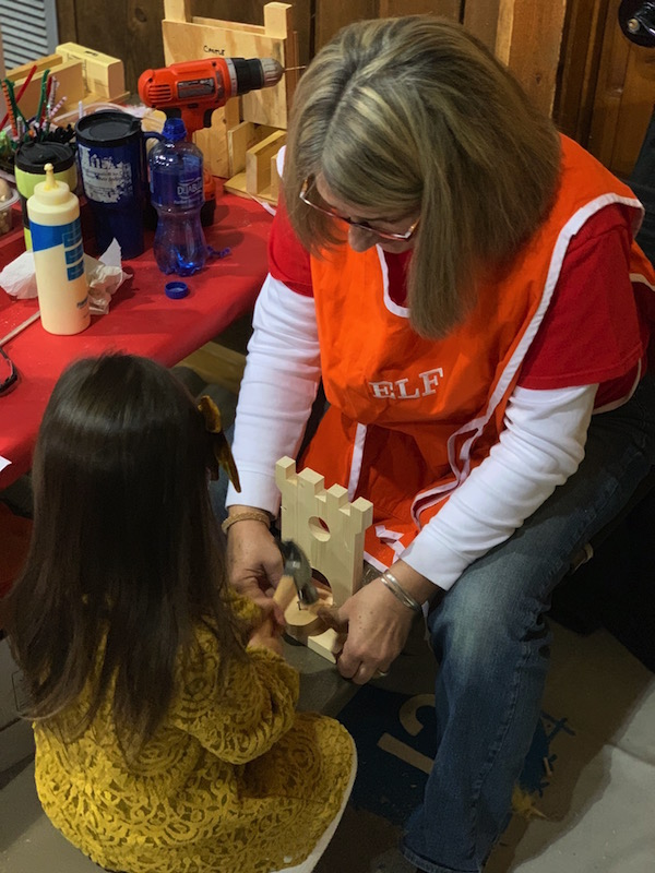 woman helping a chid build her castle at Snowflake Castle in Westerville, Ohio