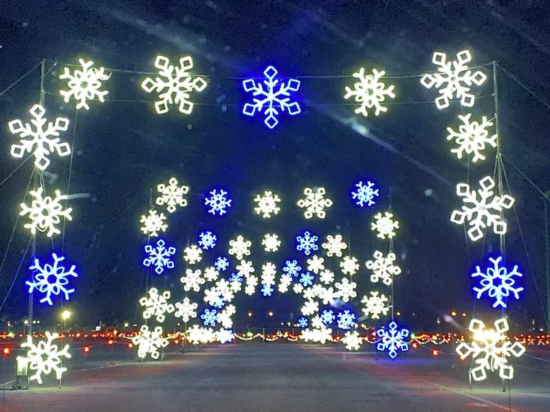 a tunnel of lighted snowflakes at National Trail Raceway - WonderLight's Christmas