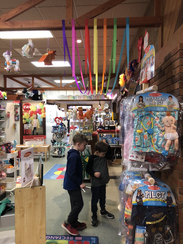 two boys inside The Fun Company in Bellefontaine, Ohio