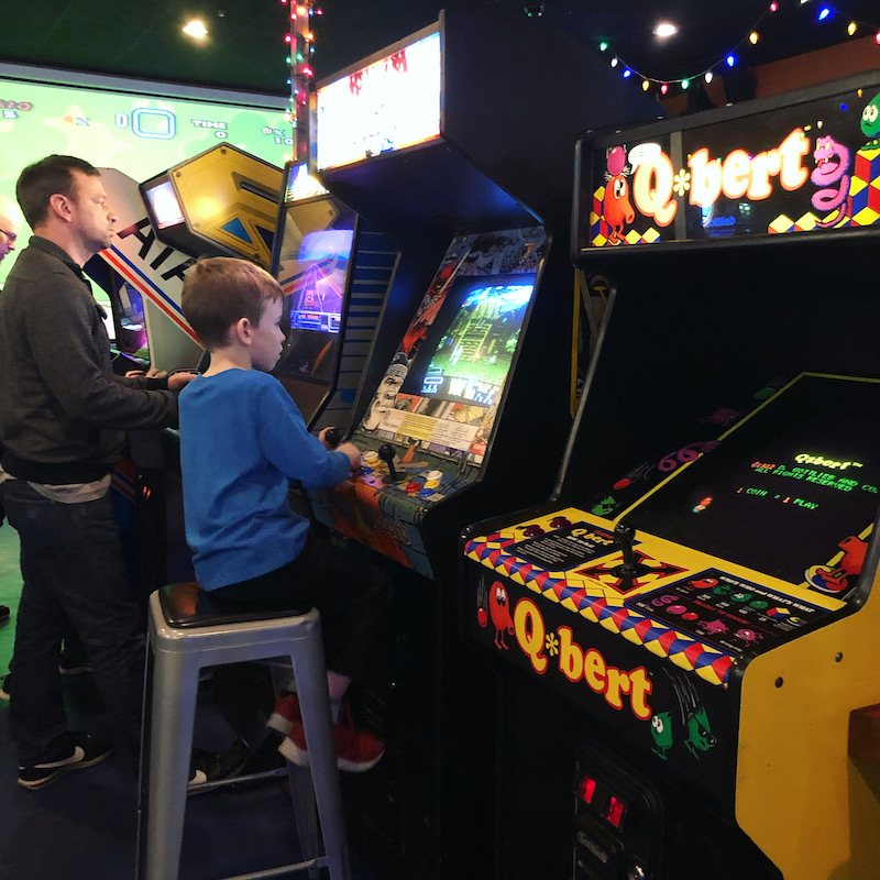 boy playing arcade games at Level One Bar and Arcade in Worthington
