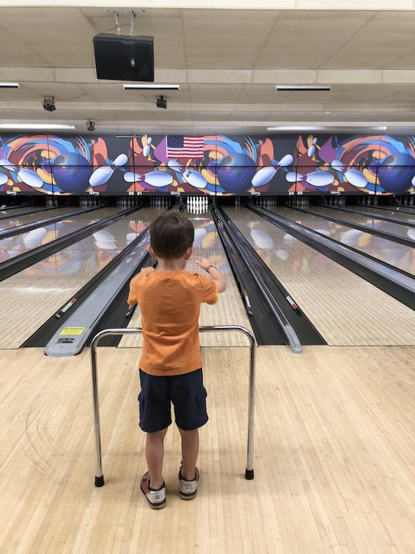 Boy bowling at RollHouse