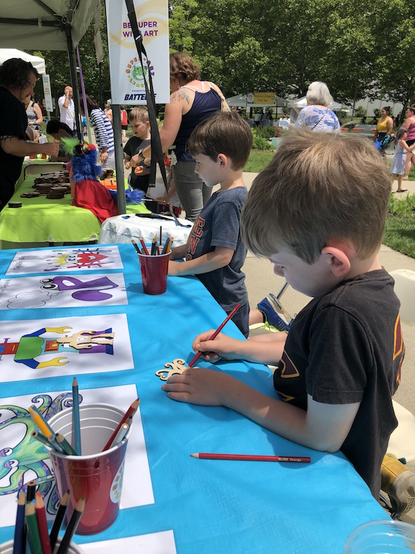 boys doing art projects at Columbus Arts Festival