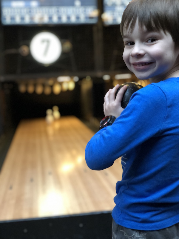 boy playing duck pin bowling at Pins Mechanical, Downtown Columbus location