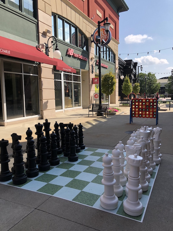 outdoor life-sized chess game at The Yard at Polaris Fashion Place