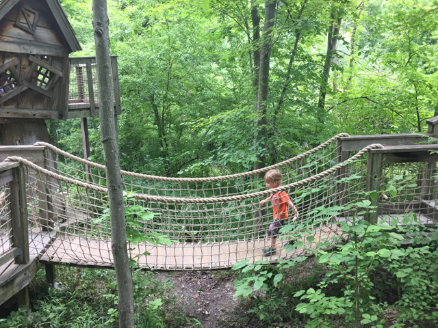 boy on wooden suspension bridge in Inniswood Metro Gardens, Columbus, Ohio