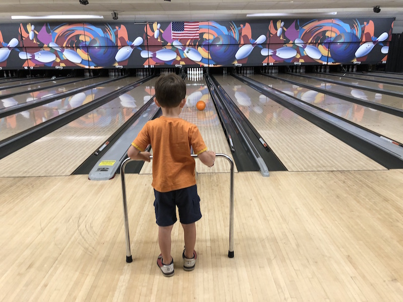 boy bowling at Rollhouse in Columbus, Ohio