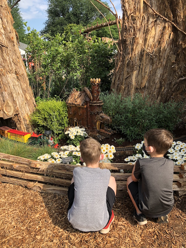 Two boys watching the train at the Garden Railway at Franklin Park Conservatory