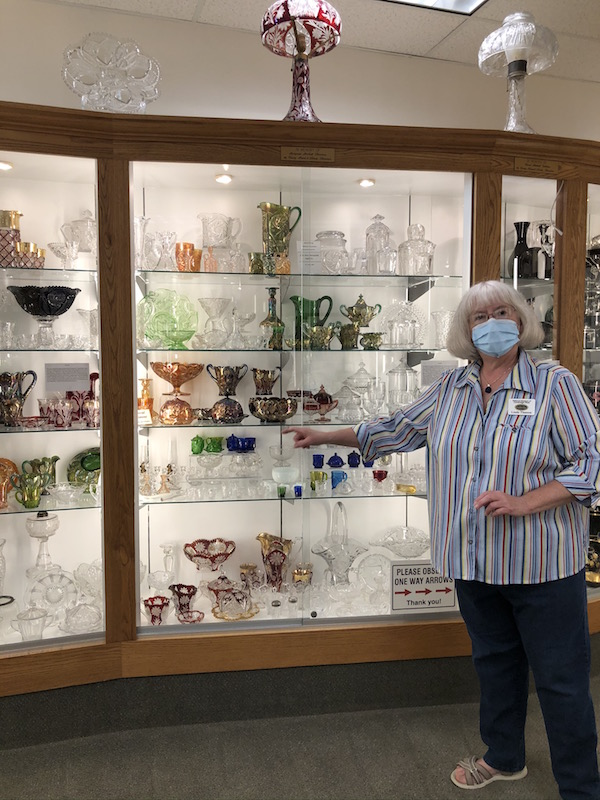 woman giving a tour at Museum of Cambridge Glass