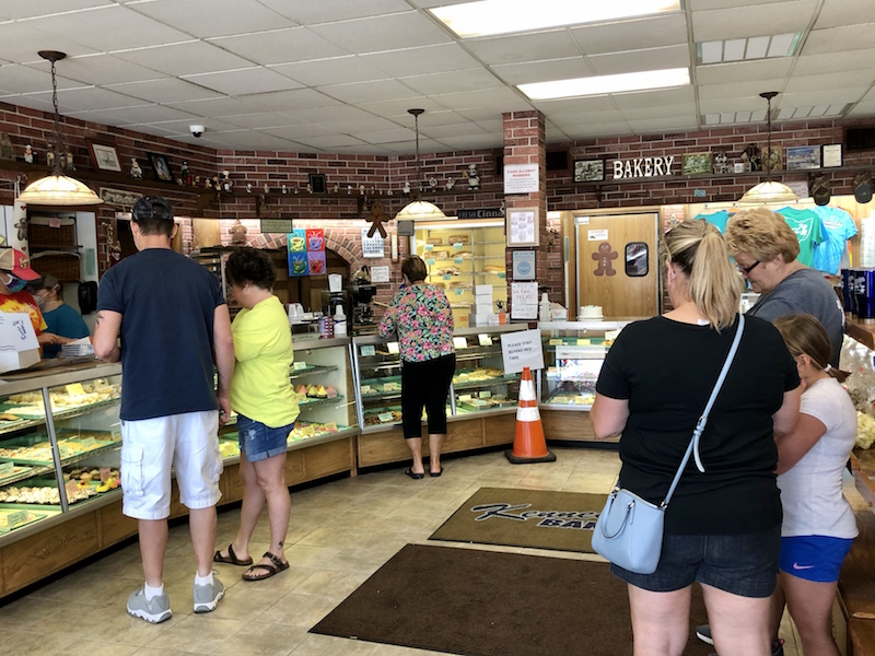 people waiting in line inside Kennedy's Bakery in Cambridge Ohio
