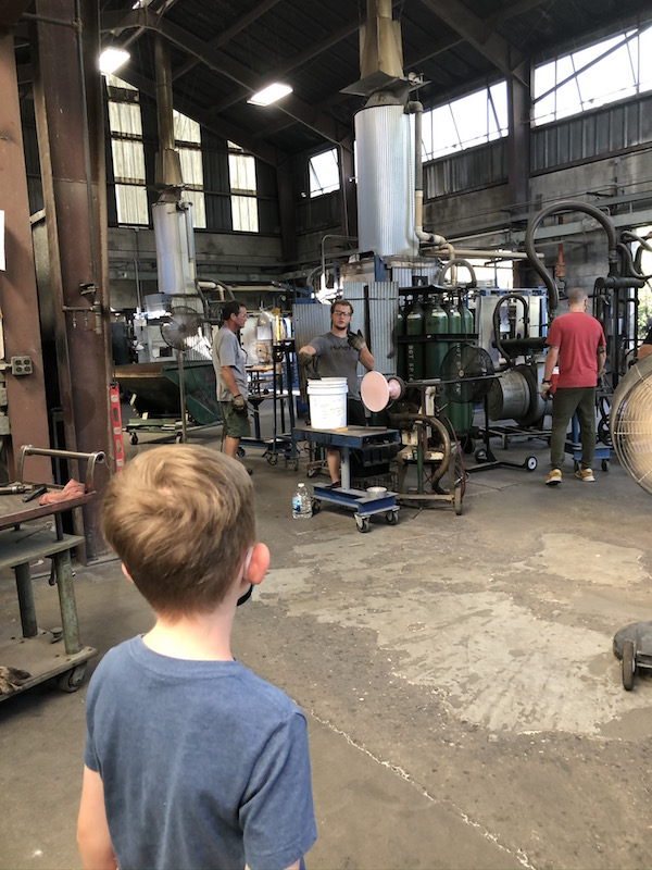 boy watching glass being made a Mosser Glass