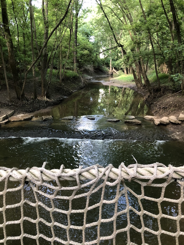 view of the creek from the rope bridge in Scioto Grove Metro Park