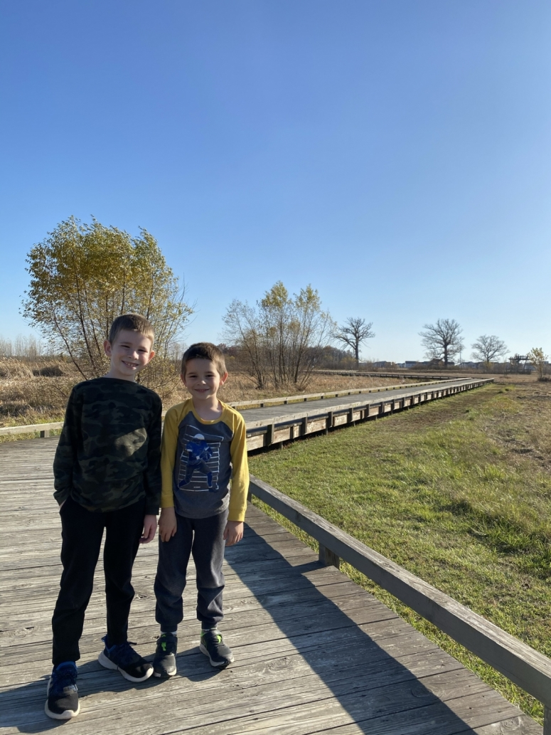 two boys on the boardwalk trail at Glacier Ridge Metro Park