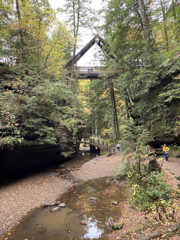 A Frame Bridge Over Gorge with people hiking underneath