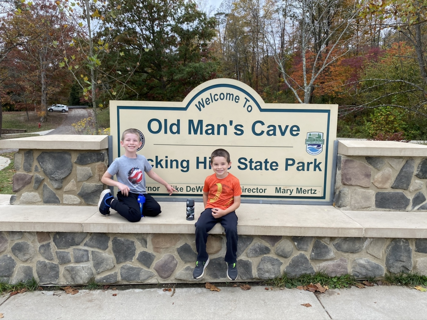 two boys in front of the Old Man's Cave sign at Hocking Hills