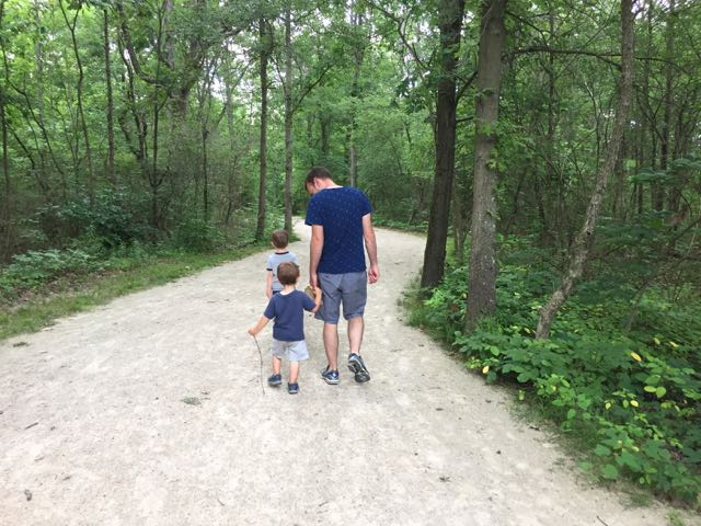 Two boys and dad walking Darby Creek Greenway Trail