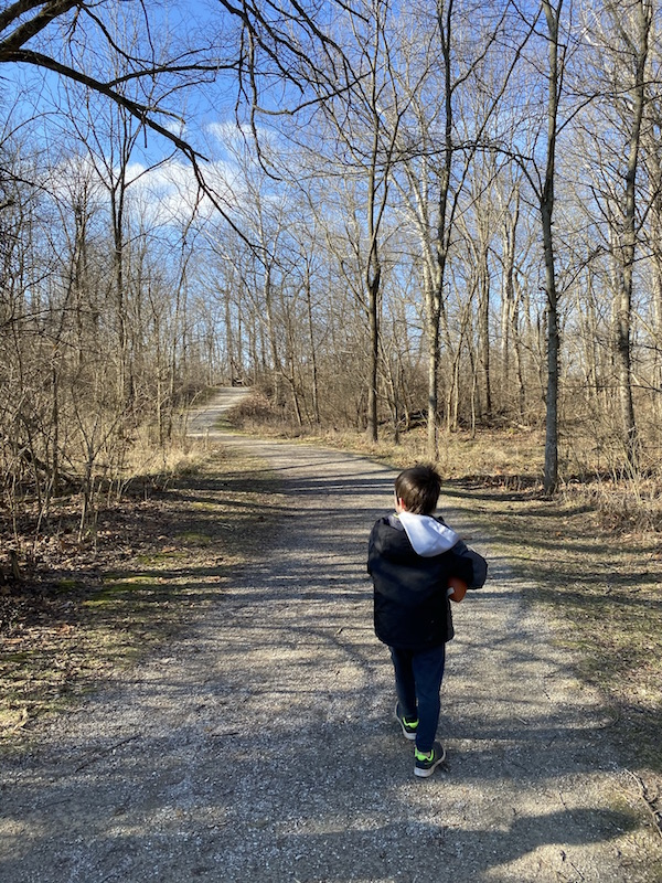 boy on riffle run trail