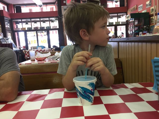 boy with a drink at Big Ed's Soda Grill in Vermilion, Ohio