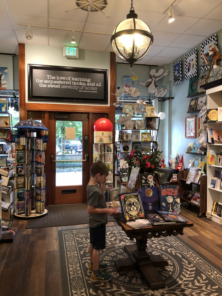 boy standing in the Cover to Cover bookstore in Upper Arlington, Ohio