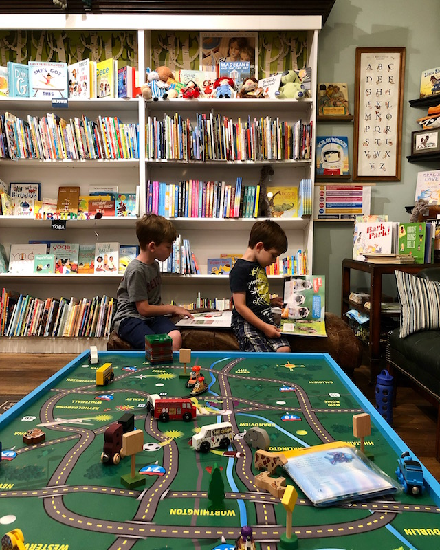 boys looking at books at Cover to Cover Bookstore in Ohio for children.