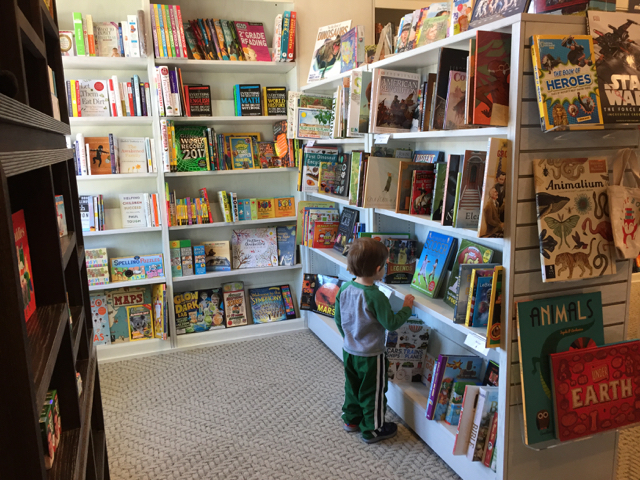a boy in the children's book area at Gramercy Books