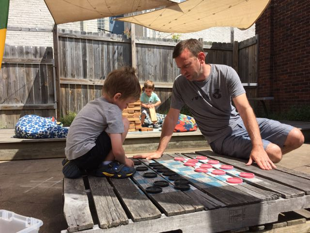 boy and dad playing checkers at Woodstock Cafe in Vermilion, Ohio