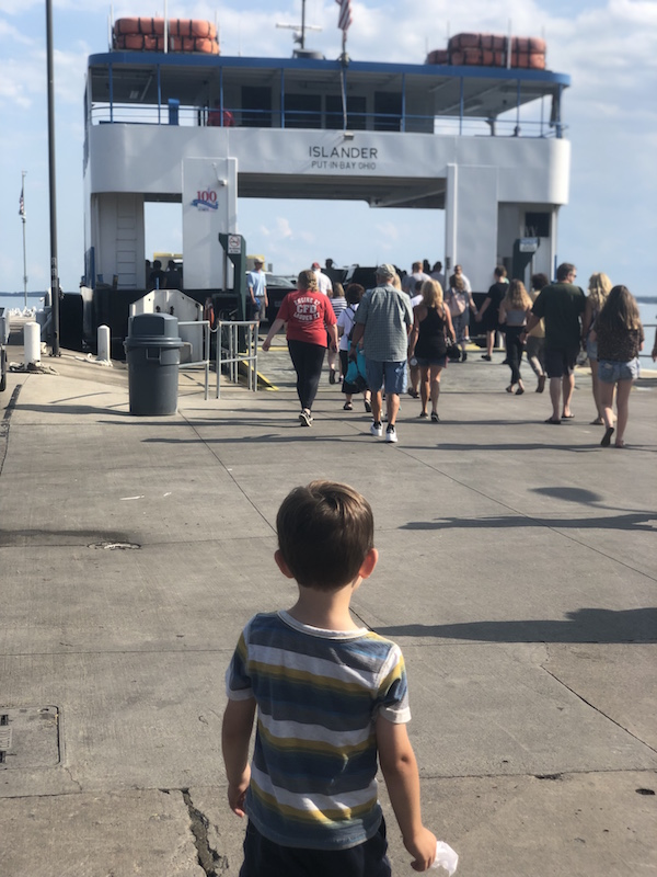 boy watching the ferry at Miller Boatline