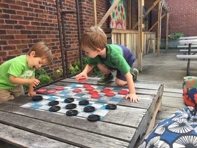 boys playing checkers at Woodstock Cafe