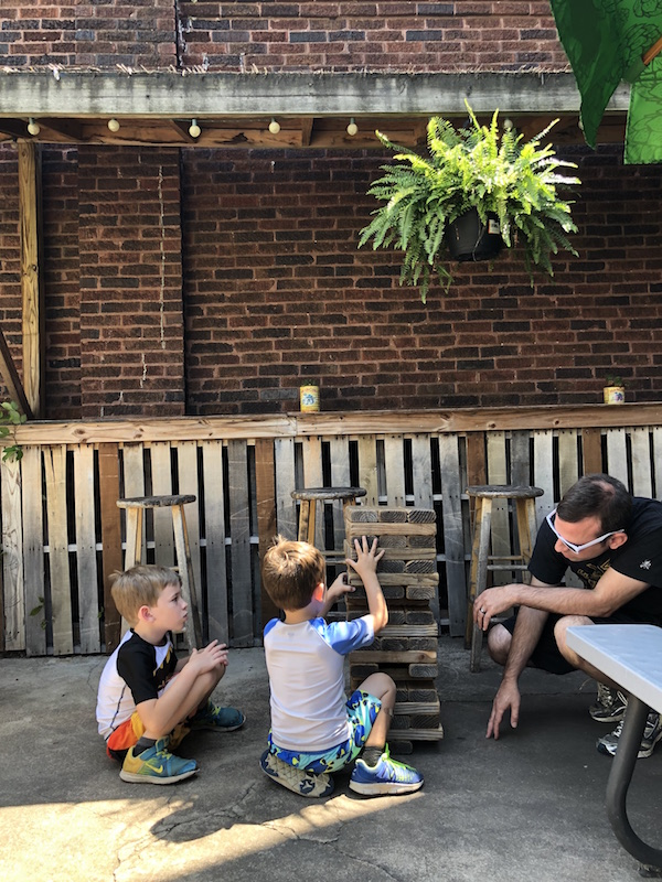 boys playing Jenga on the patio at Woodstock Cafe in Vermilion Ohio