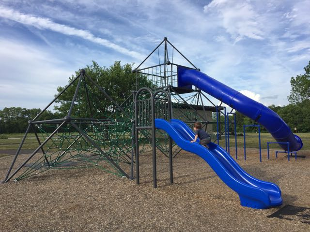 rope play structure and slides at the playground in the park.