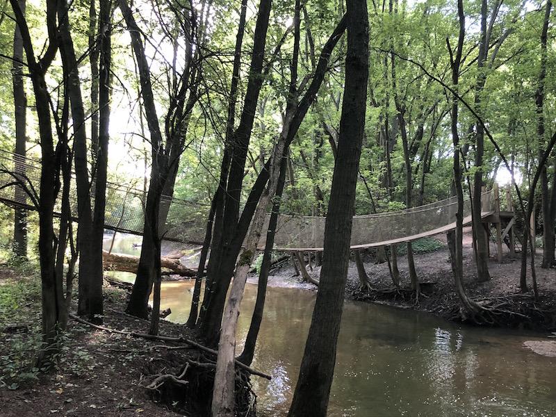 the rope bridge across the creek at scioto grove metro park.