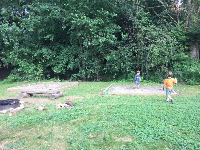 two boys playing at a backpacking site.