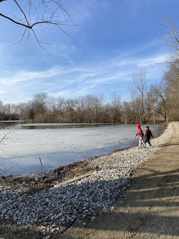 boys along the edge of the fishing pond at Scioto Grove Metro Park.