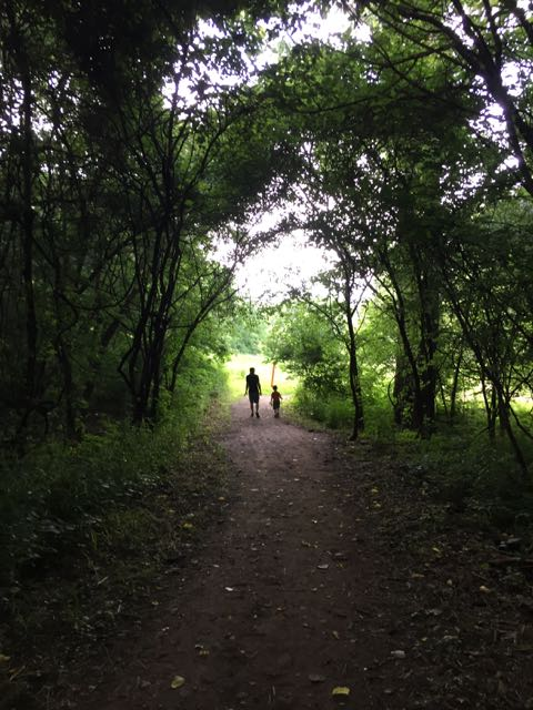 a father and son walking on the path at Scioto Grove Metro Park.