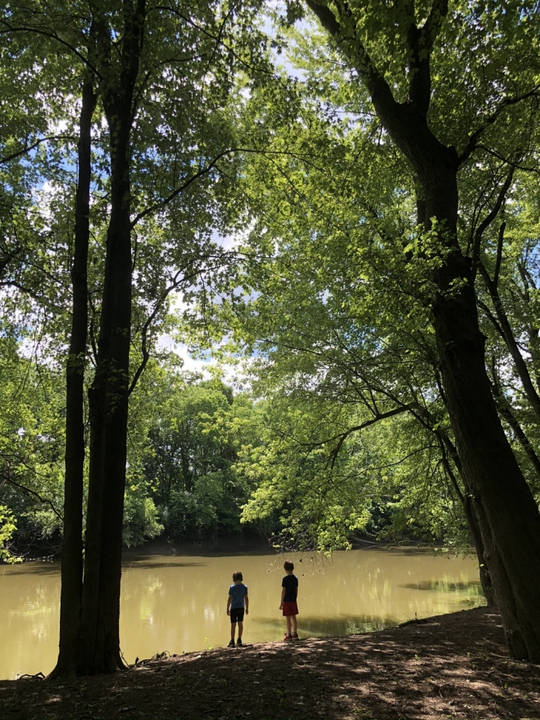 two boys standing at the edge of the Scioto River.