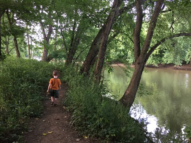 boy walking on the REI River Trail.