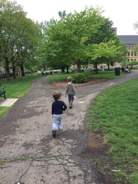 two boys walking on the path in Topiary Park in Columbus, Ohio.