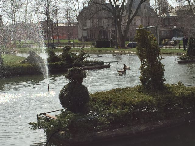 a Topiary boat in the pond.
