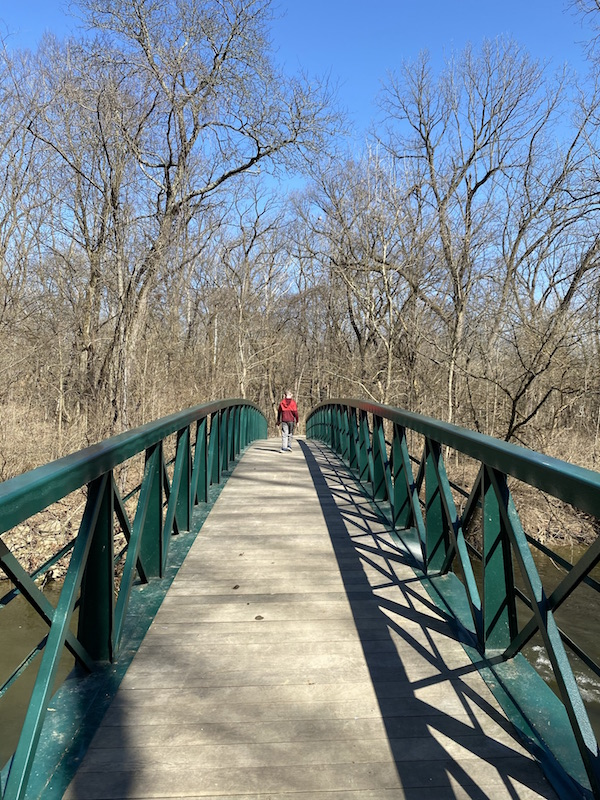 boy walking on the bridge over Big Walnut Creek in Gahanna, Ohio.