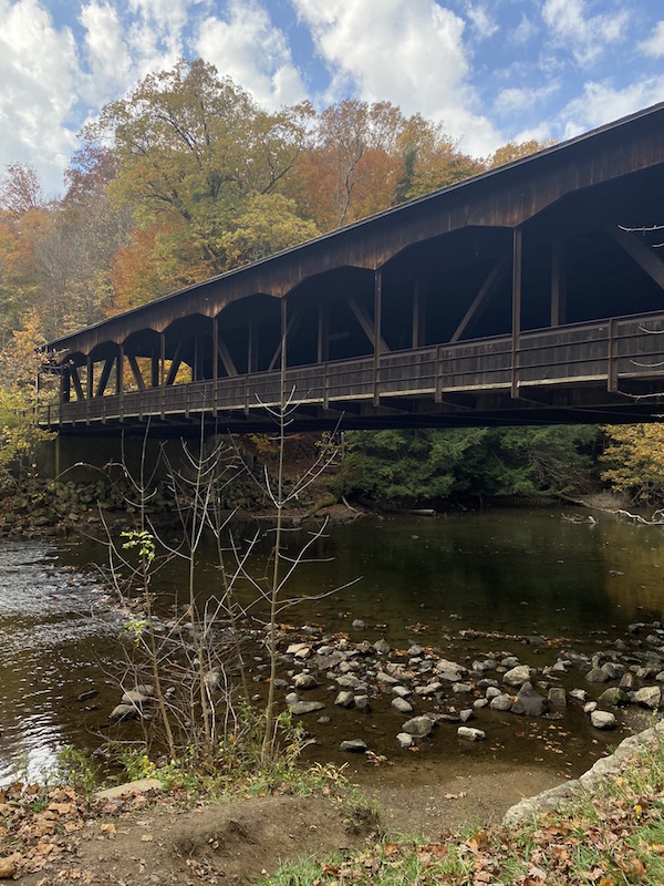view of the covered bridge across the river at Mohican.