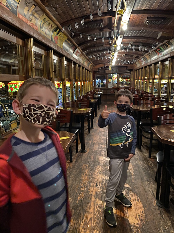 2 boys inside the train car at Spaghetti Warehouse in Columbus.