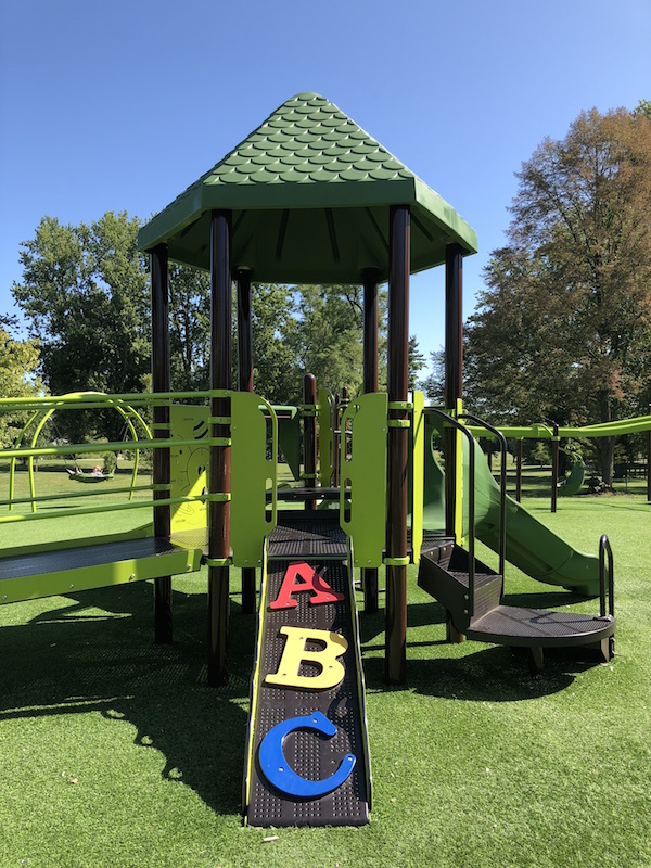 toddler play structure in the park.