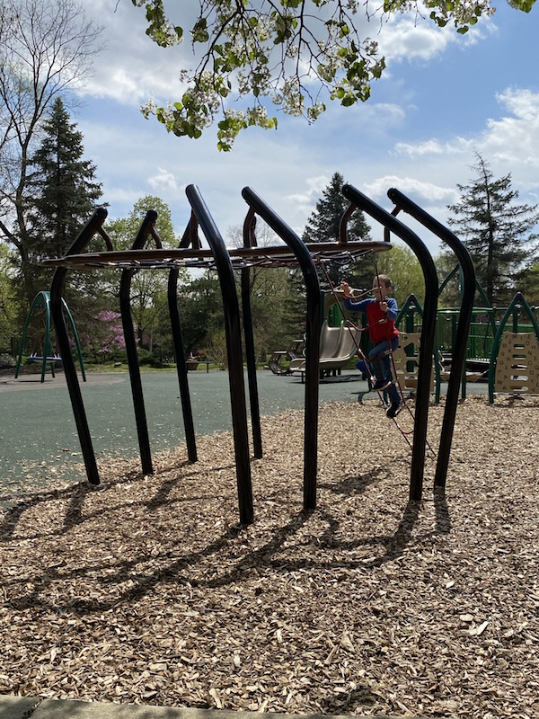 A boy playing on the playground at Franklin Park.