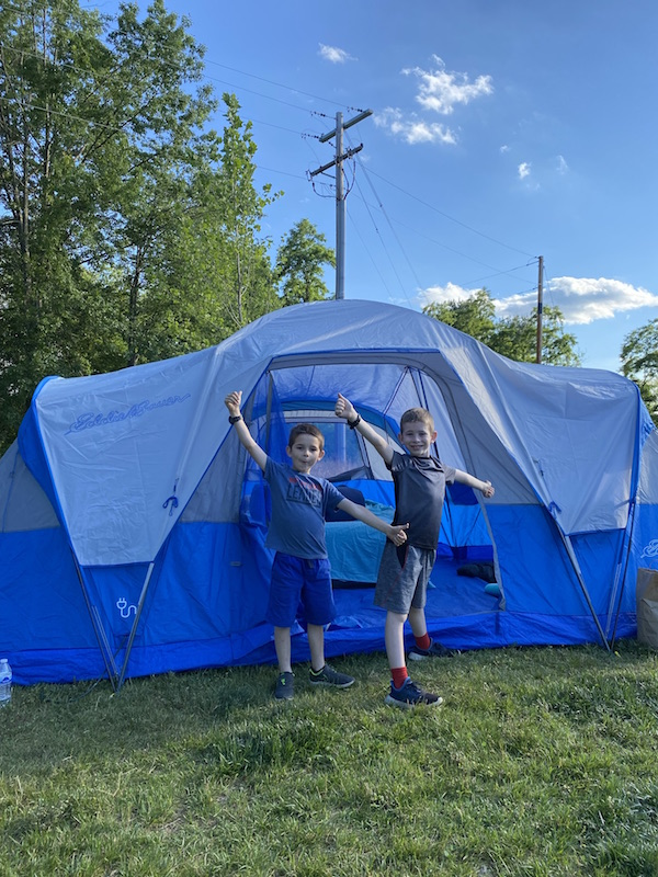 two boys in front of a tent at Pleasant Hill Lake Park.