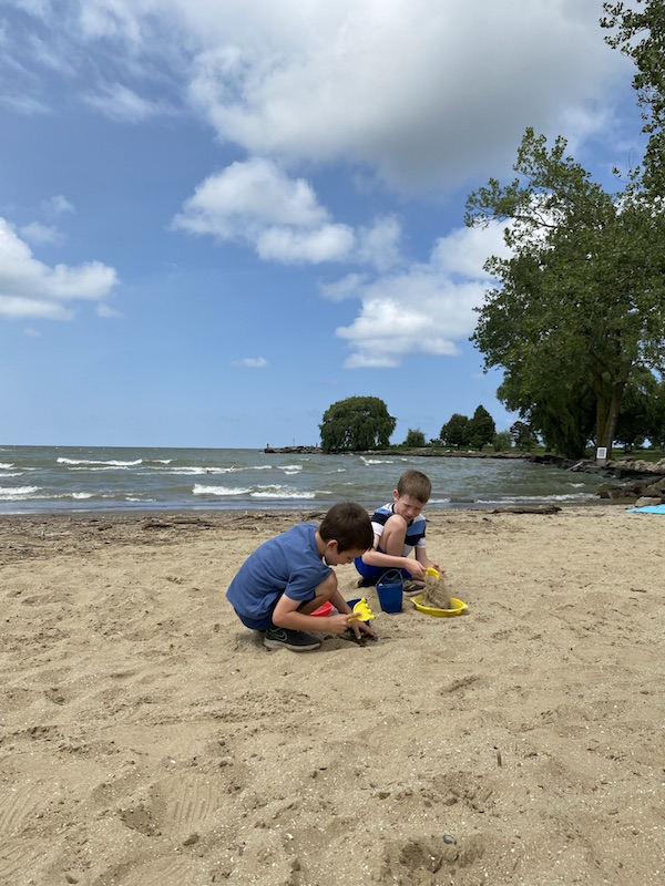 two boys playing in sand at Edgewater Beach in Cleveland.
