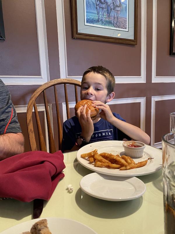 boy eating at Malabar Farm Restaurant.