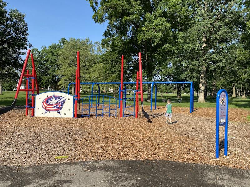 boy on playground at westgate park columbus.