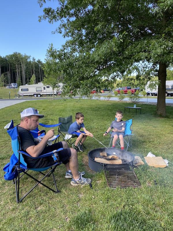 family roasting marshmallows at Pleasant Hill Lake Park.